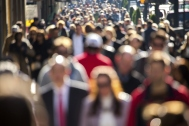 anonymous-crowd-of-people-walking-down-street